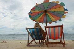 Single girl on empty beach Royalty Free Stock Photo