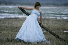 Single girl with old dress Stock Photos