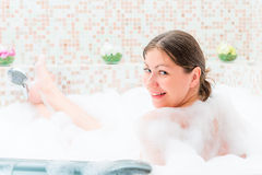 Single girl sitting in the jacuzzi Stock Image