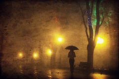 Single girl with umbrella at night alley. Royalty Free Stock Photos