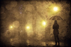 Single girl with umbrella at night alley. Stock Image