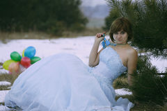 Single girl at the winter field Royalty Free Stock Photography
