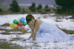 Single girl at the winter field Stock Images