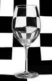 Single glass on black and white square background Royalty Free Stock Photography
