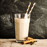 Single glass of blended cinnamon drink with straws Royalty Free Stock Image