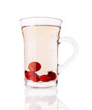 Single Glass Cup With Briar Tea Stock Photo