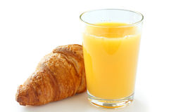 Single glass of orange juice with a croissant Royalty Free Stock Photos