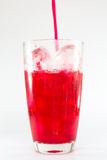 Single glass with red drink. Isolated on white background. Royalty Free Stock Image