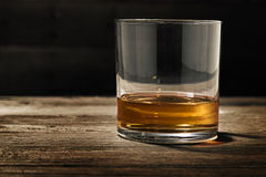 Single Glass of Straight Bourbon. One single glass of straight bourbon also known as neat Royalty Free Stock Photos