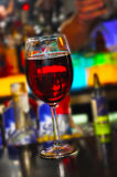 Single Glass of Wine. On the evening bar Stock Image