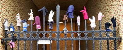 Single gloves displayed on Laugavegur Street in Reykjavik, Iceland on spiked iron fence Stock Photos