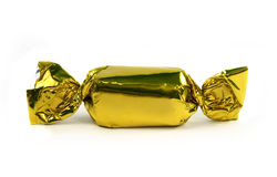 Single gold candy isolated Stock Photography