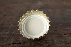 Single gold metallic bottle cap stock photos