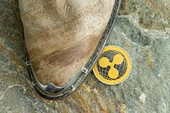 Single Ripple cryptocurrency coin on the floor Stock Image