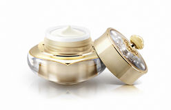 Single golden crown cosmetic jar on white Royalty Free Stock Photo