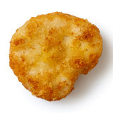 Single golden deep-fried battered chicken nugget isolated on whi Royalty Free Stock Images