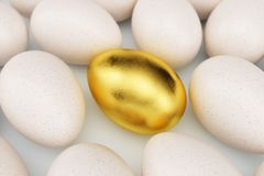 Single golden egg around white eggs, concept individuality, exclusivity and success in life. Unique golden egg. Golden stock illustration