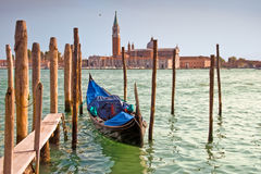 Single gondola moored on the Grand Canal, Venice, Italy Stock Images
