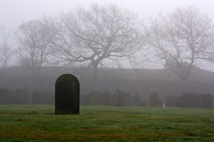 Single gravestone in a spooky graveyard Royalty Free Stock Image