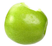 Single a green apple with bite Stock Photos