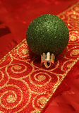 Single Green Ball on a Ribbon. A sparkling green christmas ball ornament resting on a ribbon Stock Photos