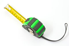 Single green and black tape measure Royalty Free Stock Photo