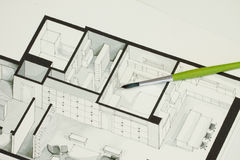 Single green brush set on real estate floor plan architectural isometric sketch sending a message for cold but elegant simplicity. In property development Stock Image