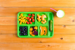 Single green lunch tray of fruit Royalty Free Stock Photos