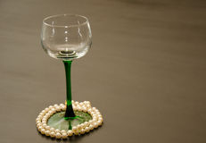 Single Green Stemmed Wine Glass with Pearl Accents Royalty Free Stock Photo