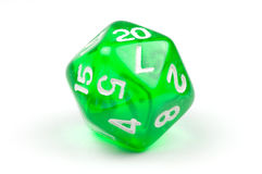 A single green, translucent 20-sided die. Macro photo of a single, green, translucent twenty-sided die, on white background Royalty Free Stock Images
