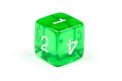 A single green, translucent six-sided die. Macro photo of a single green, translucent six-sided die, on white background Stock Photos