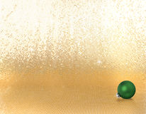 Single green xmas ornament. On a golden background Royalty Free Stock Photo