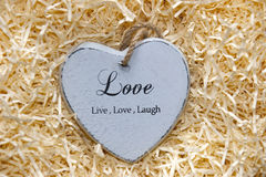 Single grey wooden heart in a love nest Royalty Free Stock Photos