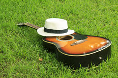 Single guitar against green grass Stock Photography