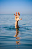 Single hand of drowning man in sea asking for help Royalty Free Stock Image