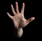Single hand isolated on black Stock Photo