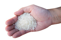 Single hand with rice Royalty Free Stock Photography