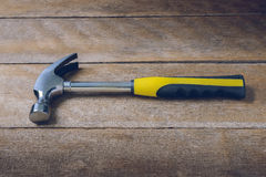 Single handed worn sledge hammer on grunge wood Royalty Free Stock Image