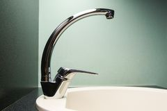 Single-handle tap in the kitchen. royalty free stock photos