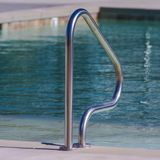 Single handrail of a swimming pool for safety royalty free stock photography