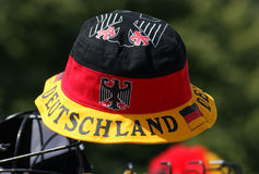 A single hat celebrating German pride sits out in the sun at a festival in Berlin, Germany. Decorated in the German colors and its cultural icons, this hat shows stock photos