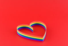 Single heart,paint of a colour gay flag in red. Single heart, paint of a six-colour gay flag on red background stock photography