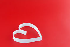 Single  heart on red . Royalty Free Stock Image