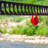 A single heart shaped red padlock symbolizing love Royalty Free Stock Image