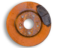 Single heavily corroded brake rotor and pad. Single heavily corroded rusty red brake rotor and worn pad or calliper isolated on white with copy space Royalty Free Stock Photos