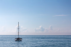 Single high-mast catamaran cruises in tropical waters Stock Photo