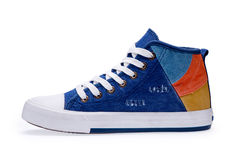 Single of high top color denim gymshoes Royalty Free Stock Images