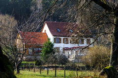 Single house in forest of Alsace, France Stock Photos