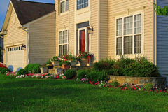 Single House with Landscaping. Colorful annual flowers and green lawn in the morning royalty free stock photos