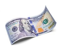 Curved Hundred Dollar Bill. Single Hundred Dollar Bill Curled Isolated on a White Background Stock Photo